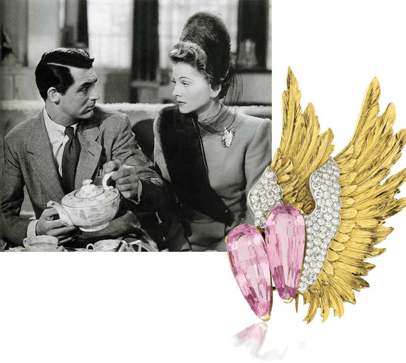 Cary Grant in scene from Suspicion, with joan fontaine, wearing Verdura's pink tourmaline wing brooch